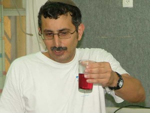 Professor Zohar Amar from the Temple Institute dissolves a single Crimson Worm in a glass of water and shows the dye that results.
